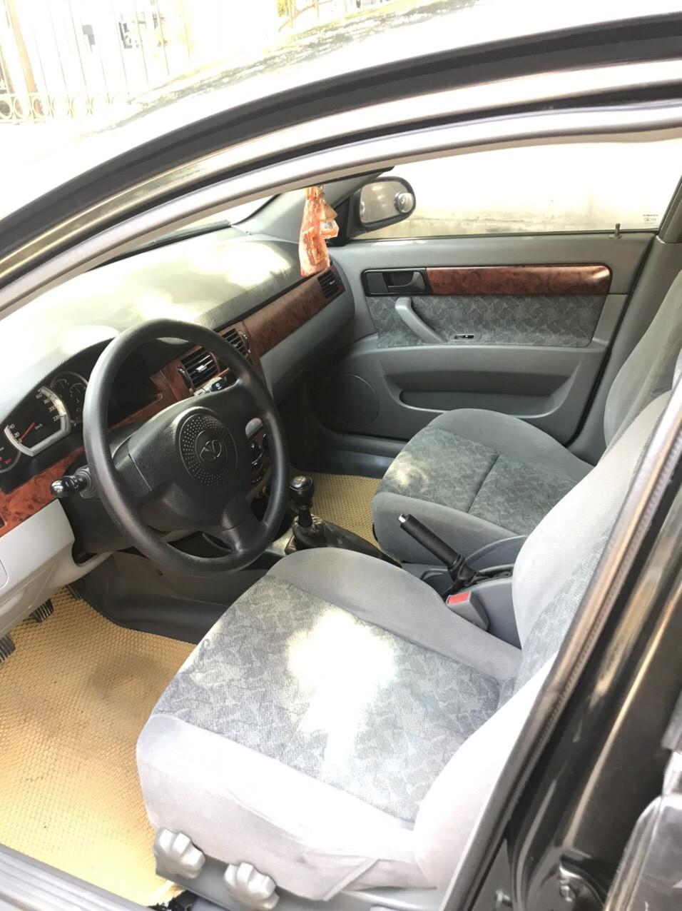 Bán ô tô Daewoo Lacetti 2010, màu đen, số sàn