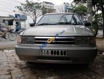 Cần bán Ford Laser đời 1993, màu bạc