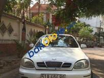 Tôi cần bán lại xe Daewoo Lanos MT đời 2006, màu trắng đã đi 100000 km, giá 140tr