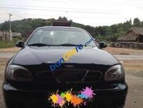 Gia đình bán ô tô Daewoo Lanos MT đời 2001, màu đen đã đi 95000 km giá cạnh tranh