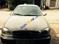 Cần bán gấp Daewoo Lanos đời 2003, màu trắng đã đi 200000 km, giá chỉ 100 triệu