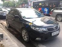 Bán xe Kia Cerato 1.6AT đời 2010, màu đen, nhập khẩu