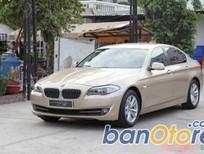 Bán xe BMW 5 Series 528i đời 2010, màu vàng