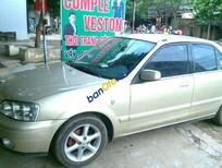 Cần bán xe Ford Laser 1.8 đời 2002, màu vàng
