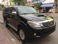 Bán Toyota Hilux 2.5E năm 2013, màu đen còn mới