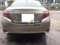 Bán Toyota Vios 1.5 E đời 2015, màu vàng