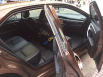 Bán xe cũ Toyota Corolla Altis 2.0 V đời 2014, màu nâu số tự động, 865 triệu