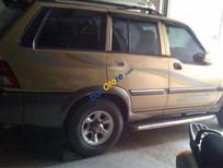 Cần bán gấp Ssangyong Musso đời 2001, màu vàng, 200tr