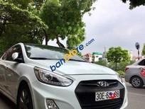 Cần bán xe Hyundai Accent AT sản xuất 2014, màu trắng, 555 triệu