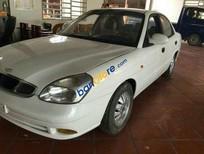 Giá đình cần đổi xe bán Daewoo Nubira đời 2002, màu trắng