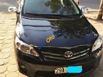 Bán Toyota Corolla Altis 1.8 đời 2011, màu đen số sàn, 565tr