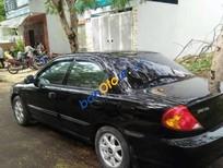 Cần bán xe Kia Cerato sản xuất 2005, màu đen chính chủ, giá 215tr