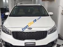 Bán Kia Grand Sedona 3.3AT màu trắng, máy xăng bản full, đăng ký tháng 9/2016
