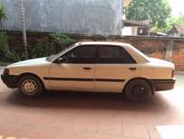 Cần bán lại xe Mazda 323 năm sản xuất 1995, màu trắng