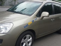Bán ô tô cũ Kia Carens đời 2015, màu vàng