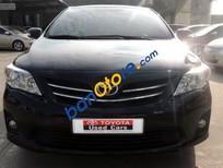 Bán xe cũ Toyota Corolla altis 1.8AT đời 2013, màu đen số tự động, 710 triệu