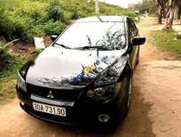 Cần bán gấp Mitsubishi IO đời 2009, màu đen, nhập khẩu