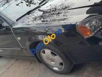 Cần bán lại xe Daewoo Magnus năm sản xuất 2004, màu đen, giá tốt