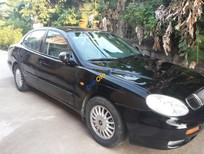 Cần bán gấp Daewoo Leganza CDX năm sản xuất 1997, màu đen, xe nhập, 110 triệu