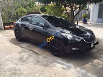 Cần bán lại xe Kia K3 MT năm 2015, màu đen số sàn