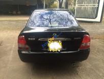 Em cần bán xe Mazda 323F 1.6 MT sản xuất 2004, màu đen xe gia đình