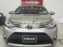 Bán Toyota Vios E sản xuất năm 2017, màu vàng cát