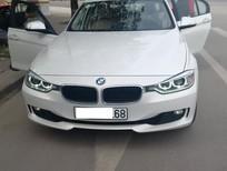BMW 320i 2013 màu trắng nội thất be, xe lên larang soport cực chất, giao xe ngay bán xe trả góp