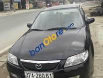 Bán lại xe cũ Mazda 323 sản xuất 2002, màu đen