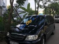 Cần bán xe Kia Carnival năm sản xuất 2009, màu đen, giá 350tr