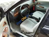 Cần bán Daewoo Nubira đời 2004, màu đen chính chủ