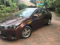 Bán Toyota Corolla altis 1.8MT năm sản xuất 2014, màu nâu chính chủ, 668 triệu