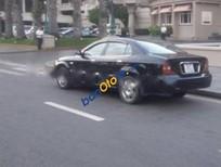 Cần bán Daewoo Magnus AT năm sản xuất 2004, màu đen còn mới