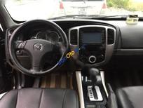 Cần bán Mazda Tribute đời 2009, màu đen, xe nhập số tự động