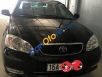 Bán Toyota Corolla J sản xuất năm 2003, màu đen số sàn, 233tr