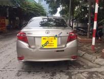 Cần bán gấp Toyota Vios 1.5 E đời 2015, màu vàng, giá 535tr