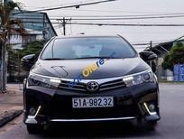 Cần bán gấp xe cũ Toyota Corolla đời 2014, màu đen