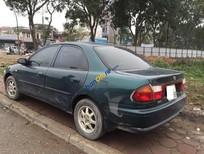 Cần bán Mazda 323 GLXi năm 1999, màu xanh lục, nhập khẩu xe gia đình