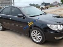 Bán xe cũ Toyota Camry 3.0AT sản xuất 2004, màu đen, giá 450tr