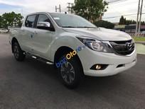 Cần bán xe Mazda BT 50 2.2 MT sản xuất năm 2016, màu trắng, nhập khẩu nguyên chiếc, giá chỉ 635 triệu
