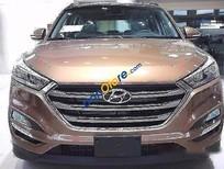 Cần bán xe Hyundai Tucson AT sản xuất 2016, màu nâu