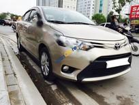 Bán Toyota Vios 1.5E đời 2015, màu kem (be) số sàn