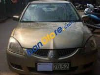 Cần bán lại xe Mitsubishi Lancer AT sản xuất năm 2004, màu vàng đã đi 120000 km, giá 240tr