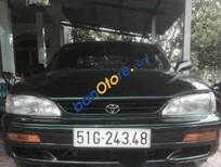 Tôi cần bán xe Toyota Camry AT đời 1996, màu đen, nhập khẩu