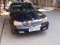 Cần bán Daewoo Magnus 2.5AT sản xuất 2004, màu đen