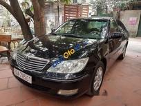 Bán xe cũ Toyota Camry 3.0 đời 2003, màu đen chính chủ, giá chỉ 385 triệu