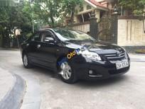 Cần bán gấp Toyota Corolla altis 1.8AT đời 2010, màu đen, giá 570tr