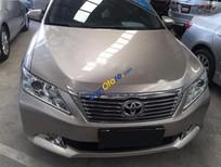 Cần bán gấp Toyota Camry 2.0E đời 2012, màu vàng, 875tr