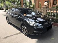 Cần bán xe Kia K3 đời 2014, màu đen