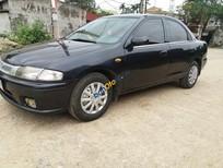 Cần bán xe Mazda 323 đời 2000, màu đen