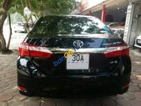 Bán xe cũ Toyota Corolla altis 1.8G 2015, màu đen số tự động